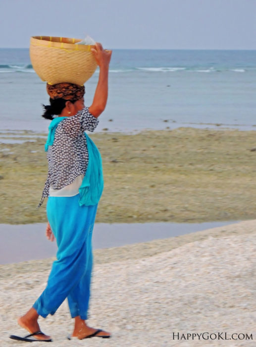gili meno woman carrying a basket