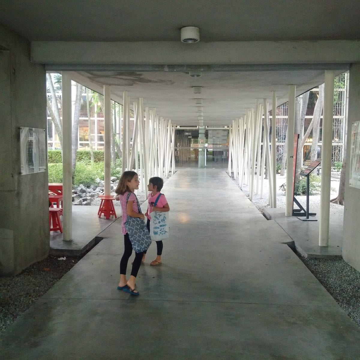 Two little girls on way into KLPAC for rehearsal