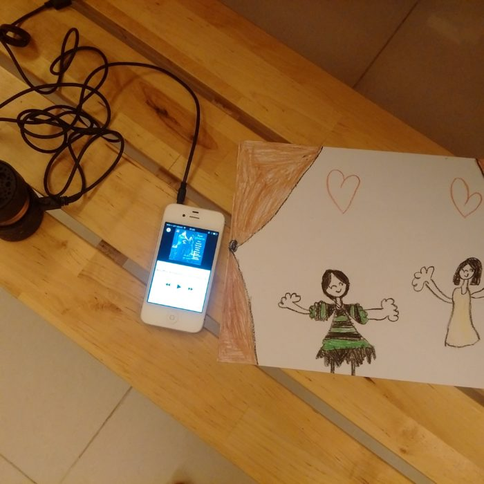 ipod playing la boheme and kids art portraying stage